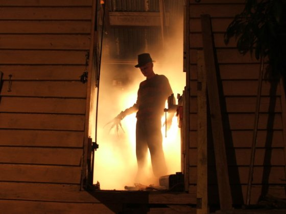 Cover for the short story about Freddy Krueger's origins, he stands in the doorway of his burning work shed, the parents of Elm Street taking their vengeance.