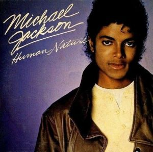 Image of Michael Jackson for Human Nature, music video script has him strolling New York streets at predawn giving to the less fortunate.