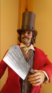 Bill the Butcher toy holding a cleaver for the short story Becoming Bill.