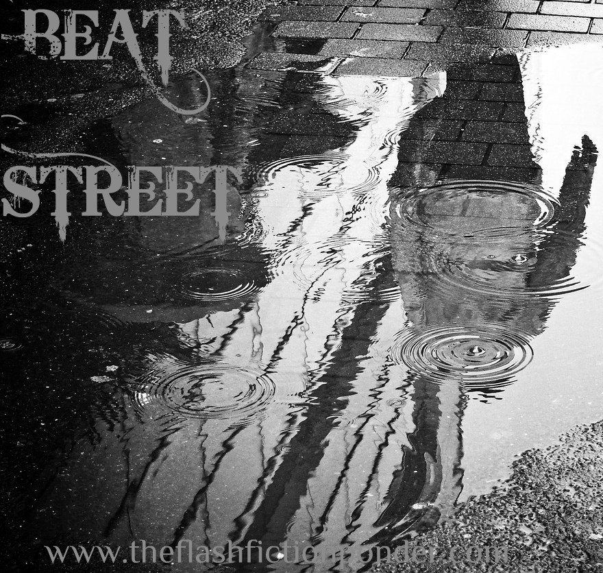 Reflection of man walking gritty streets, image to Beat Street by Rico Lamoureux of The Flash Fiction Ponder.