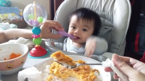 Father shows son how to eat.