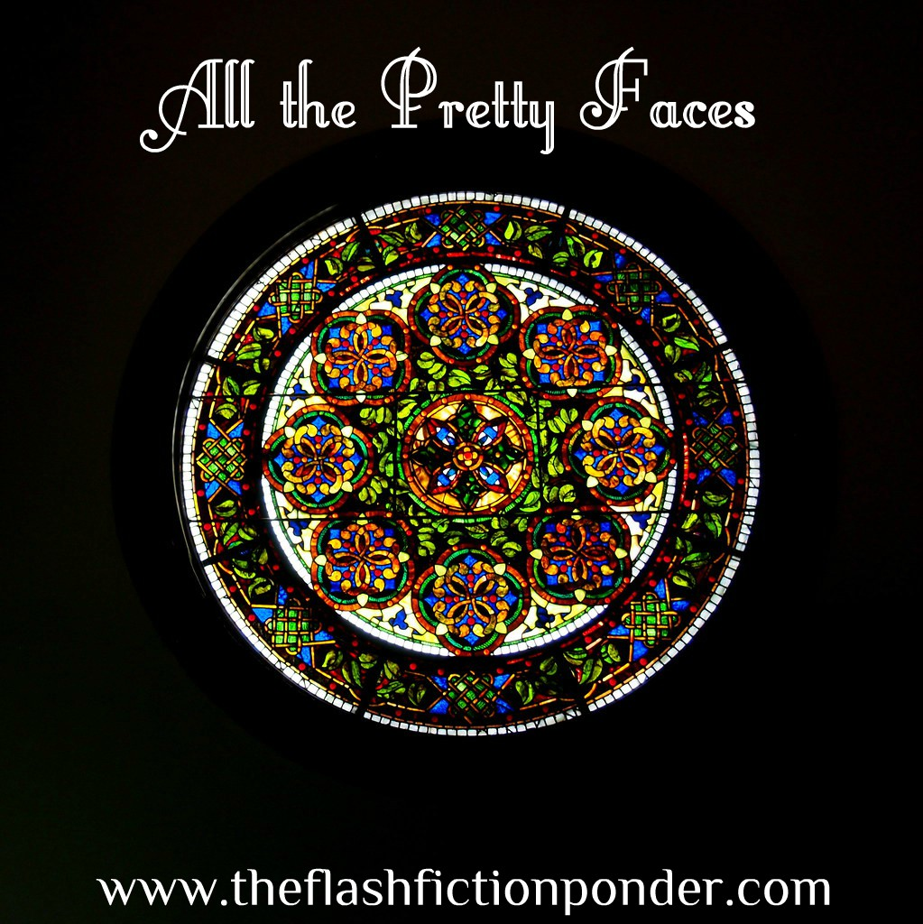 Round stained-glass window. Cover image for 'All the Pretty Faces', song by The killers, music video script by Rico Lamoureux of The Flash Fiction Ponder.