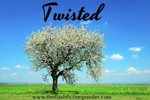 Lone cherry tree in the middle of a grassy landscape. Image for 'Twisted', song by Annie Lennox, music video written by Rico Lamoureux of The Flash Fiction Ponder.