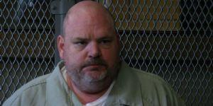Fat man prisoner in custody.