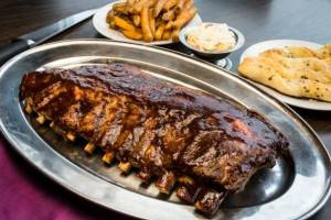 Rack of ribs with sides, image for scifi short story 'The Message' by The Flash Fiction Ponder.
