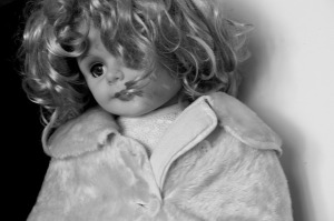Doll with lots of hair, image for Little Friend, song by Nickelback, script by Rico Lamoureux.